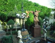 architectural garden display with gargoyle and statues