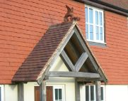dragon finial installed on a timber frame porch thumb