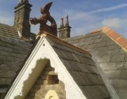 roof dragon on a slate roof with terracotta ridge tiles