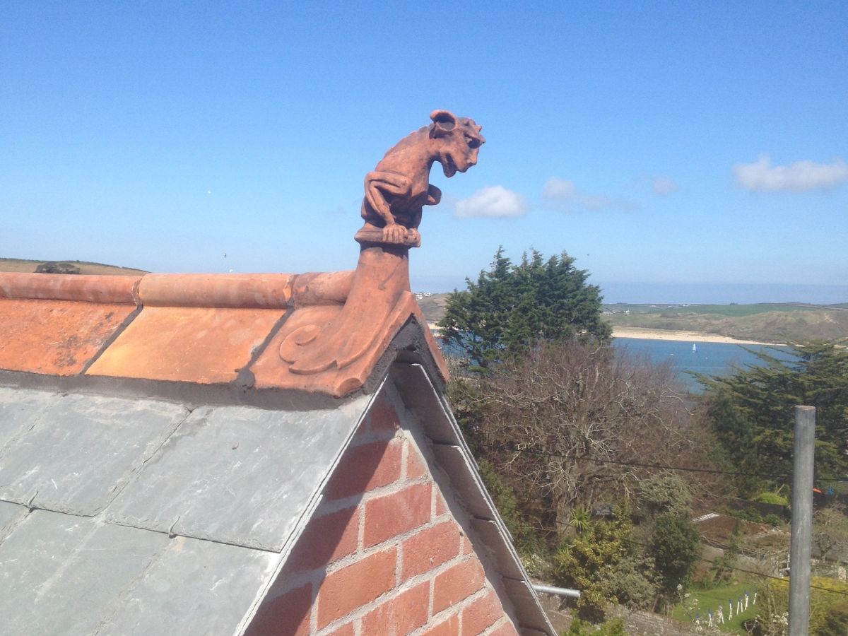 gargoyle roof finial with sea and dunes in background