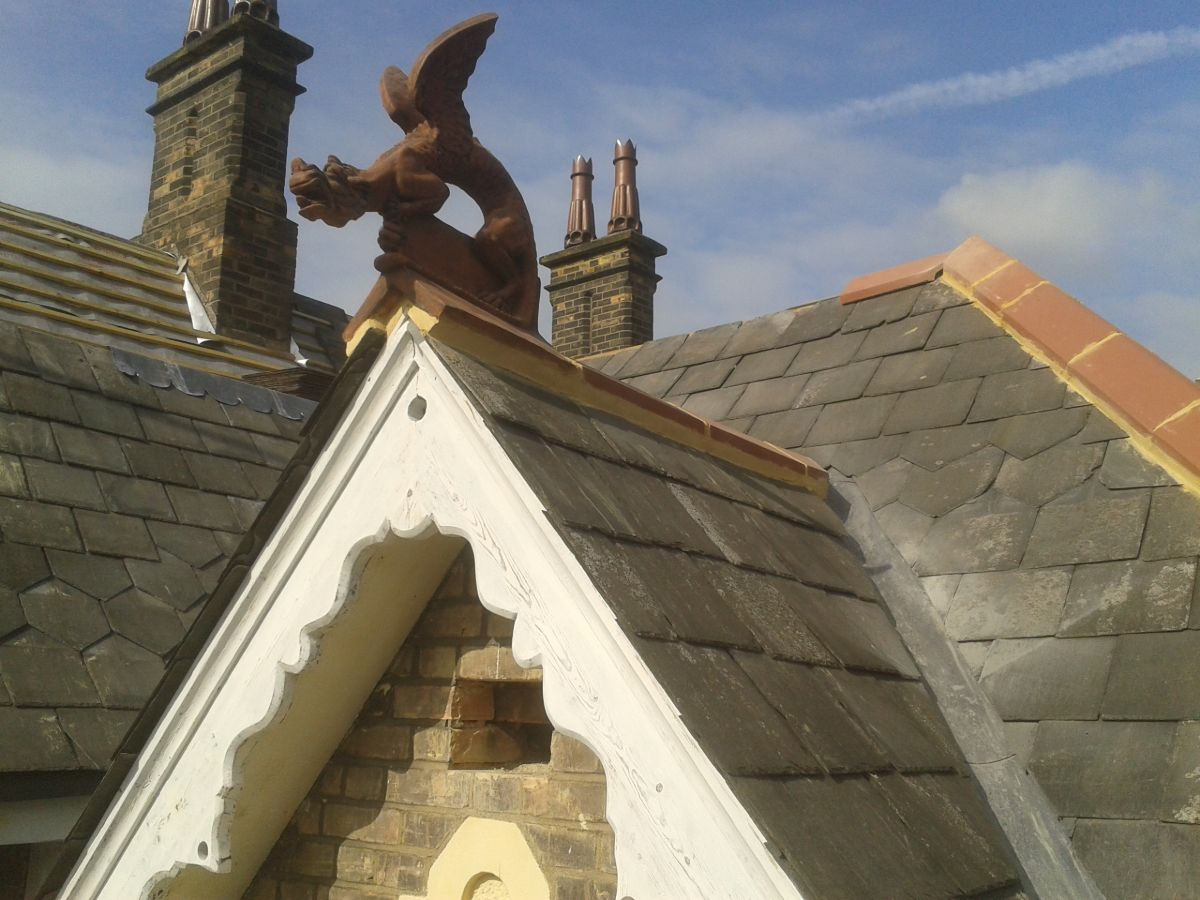 ridge dragon installed on slate roof