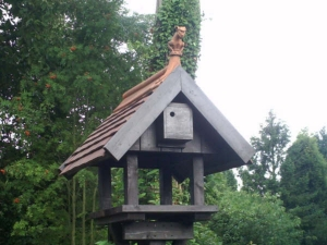 Build your own bird table with tiled roof and gargoyle finial