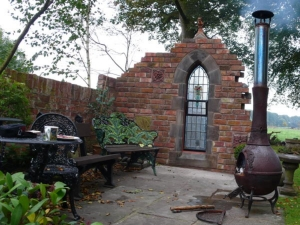 Garden folly and ruins with gothic theme and ridge gargoyle